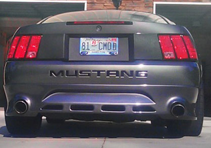 99-04 Mustang RAZZI ADD ON - Rear Bumper w/ Exhaust Holes - (ABS AERO-FLEX)